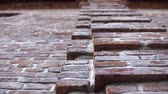 suja : Old wall with ancient crumbling brickwork, you can see the structure of the bricks. The camera is directed upwards and moves from right to left. Stock Footage