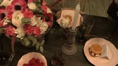 creative : View of experienced florist decorates table Stock Footage