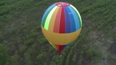 Colored balloon flying over forest aerial short Vídeos