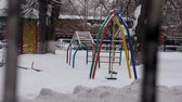 Playground in winter day with no one walking Vídeos