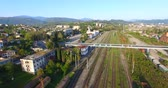 vista de cima : Top view of the cityscape with the railroad under the blue sky.