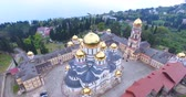 кресты : Aerial view of the Christian sights in New Athos. Abkhazia. Стоковые видеозаписи