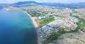 Aerial view of the seaside town of Sudak from the mountain on a summer day.