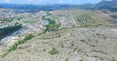 bakış açısı : Aerial view of the seaside town of Sudak from the mountain on a summer day.