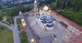 religião : Aerial view of the Christian sights in New Athos. Abkhazia. Stock Footage