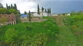 vista de cima : Top view of the ancient monastery in Dranda. Abkhazia Stock Footage