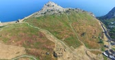 altura : Sudak, Crimea-may 20, 2018: Aerial view of the Genoese fortress on a Sunny summer evening. Stock Footage