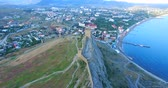 Sudak, Crimea-may 20, 2018: Aerial view of the Genoese fortress on a Sunny summer evening. Stock mozgókép