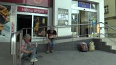 man elstv : Senior man and woman homeless in city drinking alcohol drunk, town of Olomouc, Europe, EU