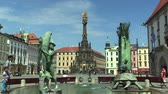 gipsy : Olomouc, Czech Republic, SEPTEMBER 1, 2016: UNESCO heritage plague column and Arion Fountain (sculptor Ivan Theimer, 2002), gypsies, gypsy children hunt coins with a magnet, town Olomouc, Europe