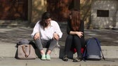conversation : BRNO, CZECH REPUBLIC, APRIL 15, 2017: Authentic students beautiful girls University in Brno sitting and talking before school, girls, boys, authentic spring, Czech Republic, Europe, EU