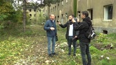 gipsy : PREROV, CZECH REPUBLIC, OCTOBER 29, 2017: Ghetto poor in Prerov, street with abandoned former Gypsy ghetto, reporter and cameraman filming a smartphone mobile report television with a microphone