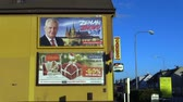 ridículo : OLOMOUC, CZECH REPUBLIC, DECEMBER 12, 2017: Billboard in support of the candidacy of President Milos Zeman in direct election to the President of the Czech Republic in 2018, people are walking Vídeos