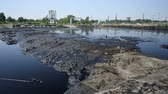 fontes : The former dump toxic waste, effects nature from contaminated soil and water with chemicals and oil, environmental disaster, contamination of the environment