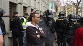капитализм : BRNO, CZECH REPUBLIC, MAY 1, 2017: Police riot unit oversees, gypsy man, czech activists protest first may day against extremists. Demonstration of radical extremists, suppression of European Union