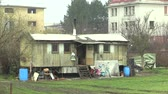 gypsy : OLOMOUC, CZECH REPUBLIC, JANUARY 18, 2018: A trailer home for gypsy nomads in the city, gypsies in winter cooking and heating. Life in daily survival very cruel and authentic.