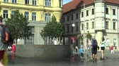 památka : OLOMOUC, CZECH REPUBLIC, AUGUST 17, 2017: Fountain with at Svobody square in Brno, family man, child and woman in the summer heat is cooled with water, people are walking around