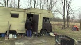 felhasználatlan : BRNO, CZECH REPUBLIC, MARCH 24, 2018: Homeless go to the place where other homeless poor people live with an old unused caravan car, searching and removing dry wood for heating and cooking