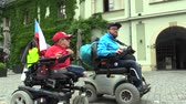 mischief : OLOMOUC, CZECH REPUBLIC, MAY 9, 2018: Two invalid men on an electric modern wheelchair, the authentic situation of the conversation, and the reality of human hard in the life of man