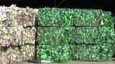 prensado : OLOMOUC, CZECH REPUBLIC, APRIL 25, 2018: Separated and pressed transparent white plastic and green bottles package ready for recycling and production of other new materials, environmentally