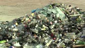palack : OLOMOUC, CZECH REPUBLIC, APRIL 25, 2018: Collection yard for different waste sorting, pile of white and colored glass bottles ready for recycling, Europe