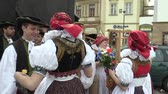 fascinante : OLOMOUC, CZECH REPUBLIC, APRIL 1, 2018: Men and woman in the traditional folk costume of Hana at the great Easter celebrations holidays in Olomouc on the Dolni Square, Paschal people are happy