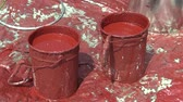 ocel : Two Synthetic Red Synthetic Paint Buckets for High Voltage Pole Laying Leading Electric Wires, painting an old steel column, Czech Republic
