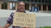 внутри : OLOMOUC, CZECH REPUBLIC, MAY 15 , 2018: Demonstration of people activist against the Prime Minister Andrej Babis a banner with the Babis, Hitler, Stalin, Mussolini, Franco
