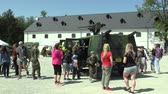 military : OLOMOUC, CZECH REPUBLIC, MAY 5, 2018: Lightweight armored vehicle Iveco LMV with 12.7 mm machine gun M2 M151 firepower with high firepower, families with children and people, day of the Army
