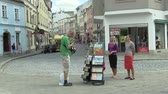 pomáhá : OLOMOUC, CZECH REPUBLIC, JULY 5, 2018: Jehovahs Witnesses religious society, two young women on the street offer books and newsletters about bible and teachings about God, free spread magazines Awake