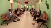 способ : OLOMOUC, CZECH REPUBLIC, JUNE 20: People are waiting in the waiting room at the office of the City Hall, the office for identification documents and permanent residence Стоковые видеозаписи