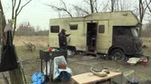 felhasználatlan : BRNO, CZECH REPUBLIC, MARCH 24, 2018: Homeless go to the place where other homeless poor people live with an old unused caravan car, life on the brink of survival, the civilization global problem