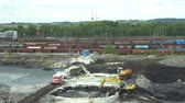 средство : OSTRAVA, CZECH REPUBLIC, AUGUST 28, 2018: Liquidation of remediation of landfills waste of oil and toxic substances, burnt lime is applied to the oil pollution by means of fine cutter excavator 4K