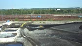 poisoned : OSTRAVA, CZECH REPUBLIC, AUGUST 28, 2018: Liquidation of remediation of landfills waste of oil and toxic substances, burnt lime is applied to oil pollution by means of fine cutter excavator bulldozer