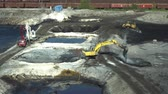 средство : OSTRAVA, CZECH REPUBLIC, AUGUST 28, 2018: Liquidation of remediation of landfills waste of oil and toxic substances, burnt lime is applied to oil pollution by means of fine cutter excavator bulldozer