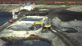 средство : OSTRAVA, CZECH REPUBLIC, AUGUST 28, 2018: Liquidation of remediation of landfills waste of oil and toxic substances, burnt lime is applied to oil pollution by means of fine cutter excavator