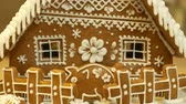 Gingerbread house and cottage cake beautiful, a fence with a piggy bank, decorated with a confectionery white icing with beaten egg whites, folk creative work, decoration for Christmas time