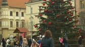 avant : BRNO, CZECH REPUBLIC, DECEMBER 21, 2018: Crowd children and christmas tree luminous and shines decorated with ornaments and flasks, people and children go walk around the square