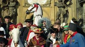 társult : OLOMOUC, CZECH REPUBLIC, FEBRUARY 29, 2019: Carnival Masopust celebration masks festival heritage plague column, traditional Slavic ethnic celebration, winter associated with folk costumes mask