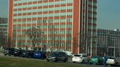 administrativo : OLOMOUC, CZECH REPUBLIC, FEBRUARY 29, 2019: Zlin Bata administrative skyscraper built in 1938 Czech Republic, cultural monument landmark functionalism, people walk on the sidewalk and cars