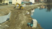 jemioła : OLOMOUC, CZECH REPUBLIC, JANUARY 30, 2019: Building flood protection on the Morava River in Olomouc, excavator and digger increases the river bank capacity for water, regulated and regulation