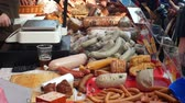 pasztet : OLOMOUC, CZECH REPUBLIC, FEBRUARY 29, 2019: Marketplace with stall products pig slaughter traditional household sausage, crowd of people shopping, weighs sausage-meat on scale, sausage