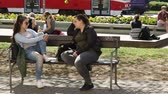 construcción de carreteras : BRNO, CZECH REPUBLIC, MAY 20, 2018: Authentic students foreign beautiful girls University in Brno sitting and talking before school, girls, boys, authentic spring, tram and car journey