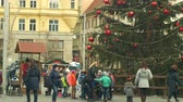 avant : BRNO, CZECH REPUBLIC, DECEMBER 21, 2018: Christmas tree luminous and shines beautiful decorated with golden ornaments and flasks red big, childrens kindergarten goes over the road, xmas ball