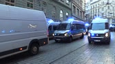 kapitalizmus : BRNO, CZECH REPUBLIC, MAY 1, 2019: Police cars with blue beacon warning light. March of radical extremists, suppression of democracy, National Social Front and the Workers Party Czech Stock mozgókép