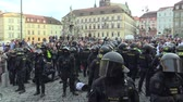 kapitalizmus : BRNO, CZECH REPUBLIC, MAY 1, 2019: Police riot detained an extremist who had acted unlawfully, handcuffed, conflict of radical extremists and activist man against radicalism, racism Stock mozgókép