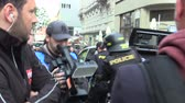 capitalisme : BRNO, CZECH REPUBLIC, MAY 1, 2019: Police riot detained an extremist who had acted unlawfully, handcuffed, conflict of radical extremists and activist man against radicalism, racism Vidéos Libres De Droits