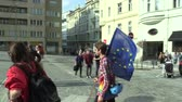 組合 : BRNO, CZECH REPUBLIC, MAY 1, 2019: Boy student holds the flag of the European Union Demonstration to support democracy in the Czech Republic. Against nationalism and fascism. Promoting globalization