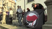 권리 : BRNO, CZECH REPUBLIC, MAY 1, 2019: Antifaschistische Aktion Flag of Antifa Antifascists at the event against the National Social Front and the Workers Party of Social Justice Czech Republic