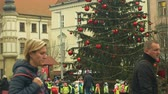 avant : BRNO, CZECH REPUBLIC, DECEMBER 21, 2018: Crowd children and christmas tree luminous and shines with ornaments and flasks xmas ball, children at wooden bell tower, joy of kindergarten bell ring
